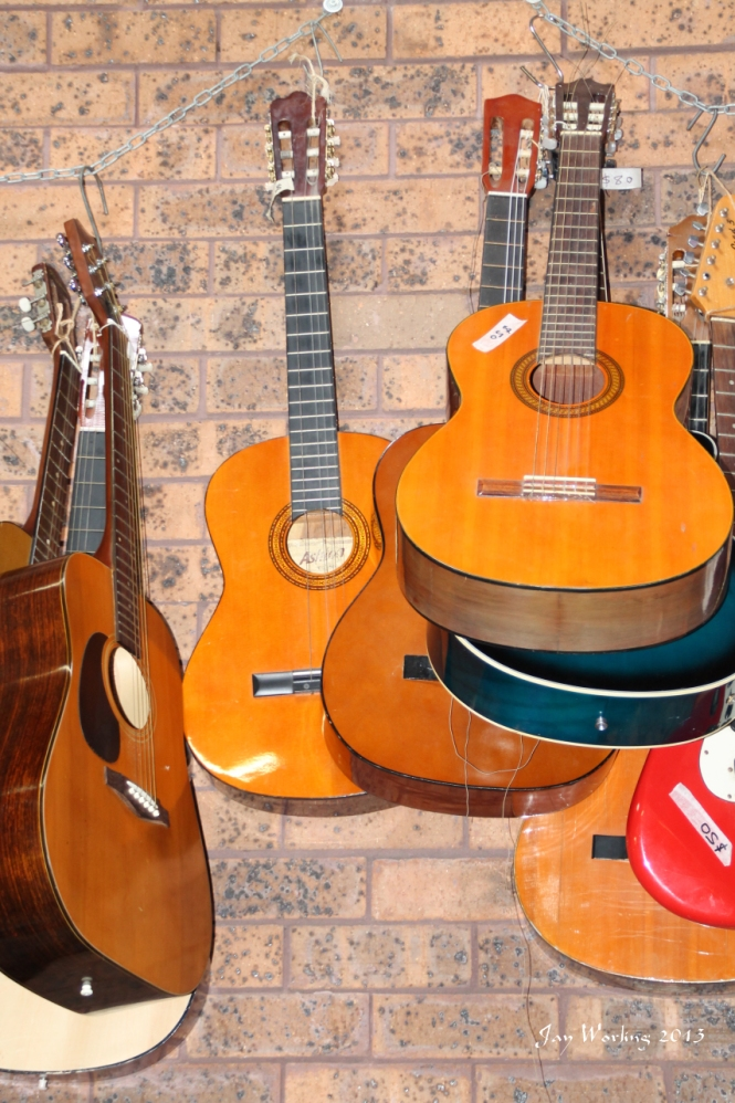 wall of discarded guitars
